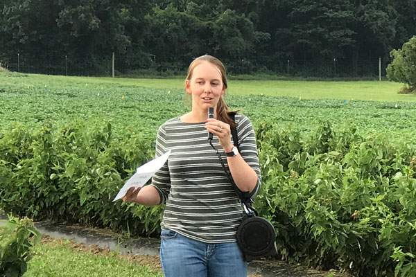 Maggie Lewis speaking about her research on spray coverage in caneberries to an audience of growers, extension agents, and university researchers at the Western Maryland Research and Education Center Horticultural Twilight Meeting and Tour