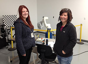 Laura Nixon and Tracy Leskey standing in front of a robot