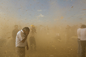 A dust devil passes near Dikmetas, Turkey, in September 2014 as thousands of refugees flee